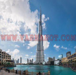 Dubai, United Arab Emirates - December 2, 2014 : View of the Burj Khalifa, the tallest building in the world. View looking to tourists by the Dubai Mall fountain.