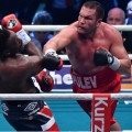 epa05294031 Kubrat Pulev of Bulgaria and Dereck Chisora (L) of Britain in action during their European Heavyweight Championship boxing match in Hamburg, Germany, 07 May 2016.  EPA/ALEX HEIMKEN