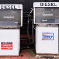 two-old-fashion-diesel-pumps-on-a-garage-forecourt-KDWY5D